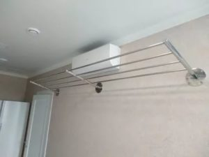 Приспособление для сушки белья на балконе
